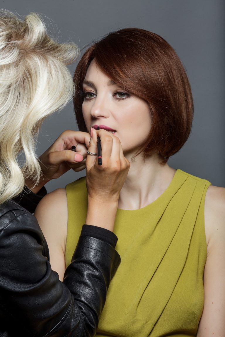 Model having makeup put applied
